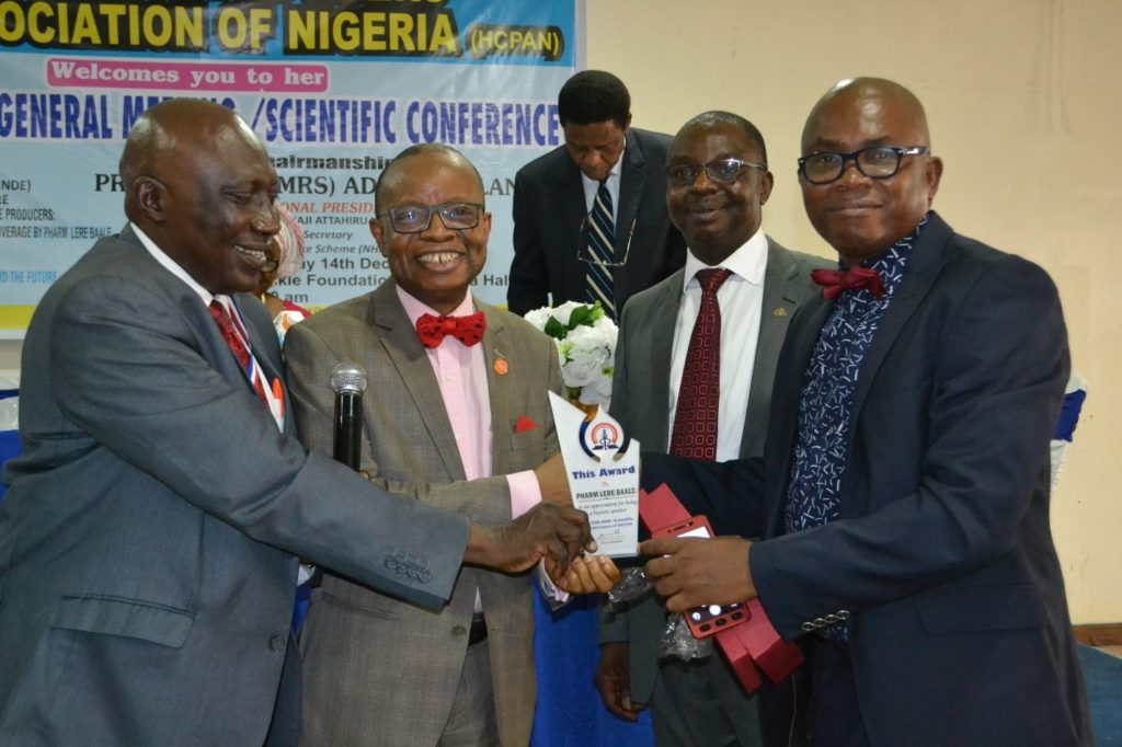 L-R: Dr Umar Sanda, president, HCPAN; Pharm. Lere Baale, director, Business School, Netherlands; Pharm. Bola Oyawole, former chairman, Lagos PSN; and Akujuobi Igwe, HCPAN national financial secretary, during the award presentation.